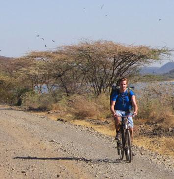 Joel biking in Bogoria