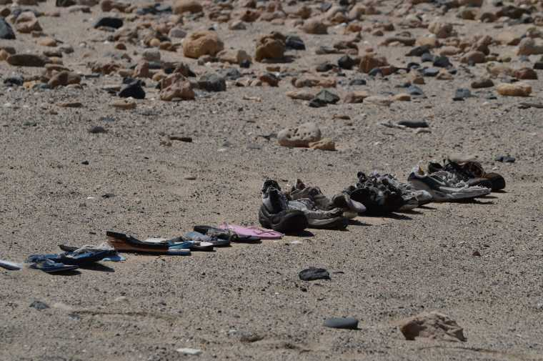 Somebody (maybe the hermit) had been amusing himself sorting out shoes brought by the sea.