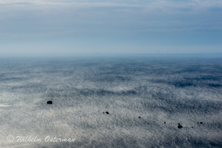 A long exposure picture from Karlsö. In the  horizon you can barely see the wind power-plants. The long exposure makes the mystic shapes of the water.
